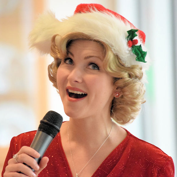 Holly singing her Christmas show